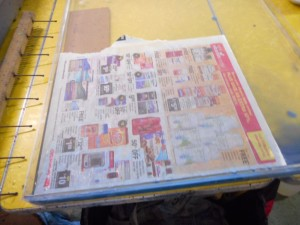 Using large newspaper as skim