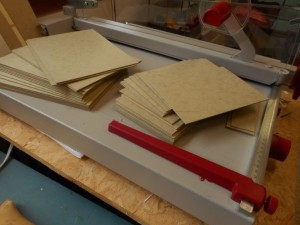 Stacks of cut Davey board for covers